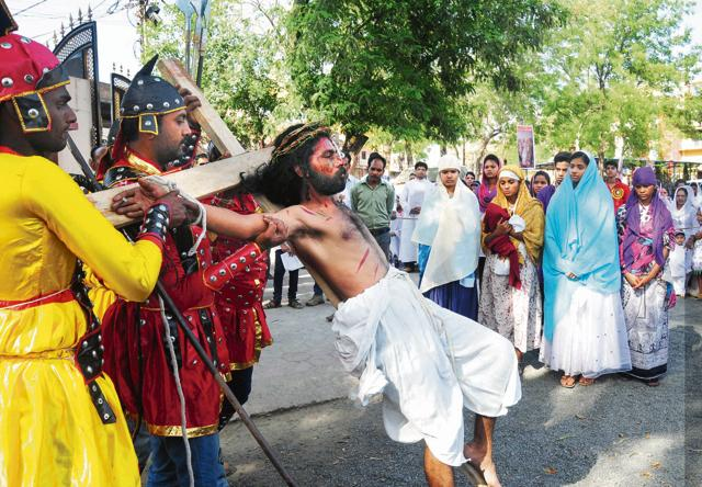 Christians re-enacting the crucifixion of Jesus christ on Good Friday at St Francis cathedral, in Bhopal, India on Friday, 03 April 2015