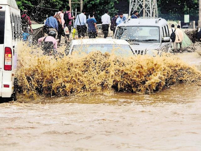 Morning rain on Wednesday once again flooded major roads of Gurgaon, but were cleared by afternoon.