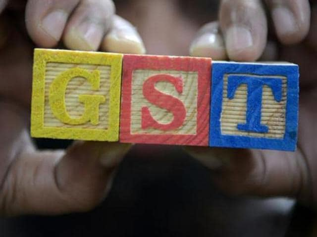 A trader shows letters GST representing 'Goods and Services Tax' at his shop in Hyderabad.