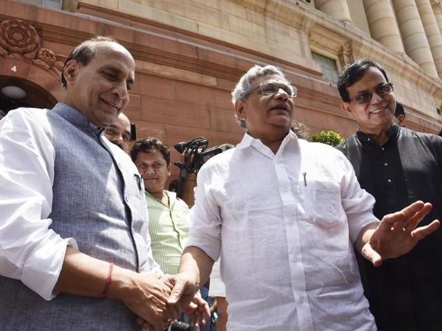 CPM chief Sitaram Yechury (centre) interacts with home minister Rajnath Singh outside Parliament.
