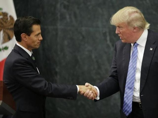 US Republican presidential nominee Donald Trump and Mexico's President Enrique Pena Nieto at a press conference at the Los Pinos residence in Mexico City on Wednesday.