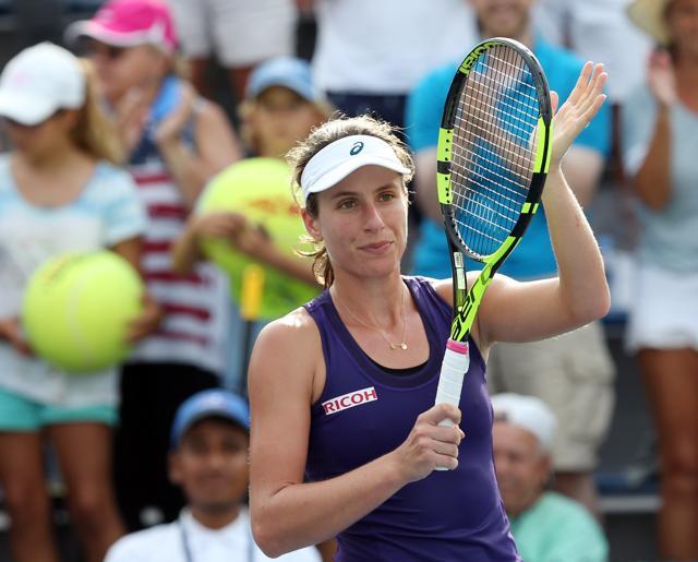 Johanna Konta of Great Britain celebrates after defeating Tsvetana Pironkova of Bulgaria.