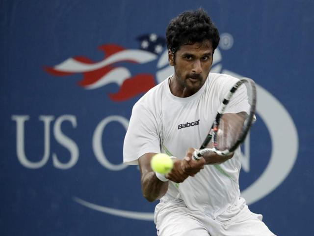 Saketh Myneni, of India, returns a shot to Jiri Vesely, of the Czech Republic, during the first round of the US Open tennis tournament, Monday, Aug. 29, 2016, in New York. (AP Photo/Julio Cortez)