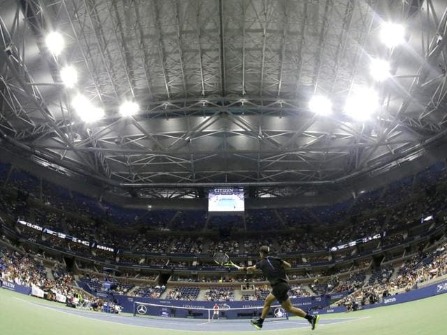 With the roof closed at Arthur Ashe Stadium, Rafael Nadal, of Spain, returns a shot to Andreas Seppi.