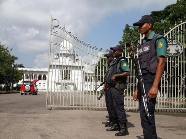 Bangladeshi police officials stand at an entrance to The Supreme Court in Dhaka.A controversial law, which has been criticised by a UN expert on human rights, authorises judges to jail anyone who deliberately publishes material deemed to hurt religious beliefs, offend the state or damage law and order for up to 14 years.