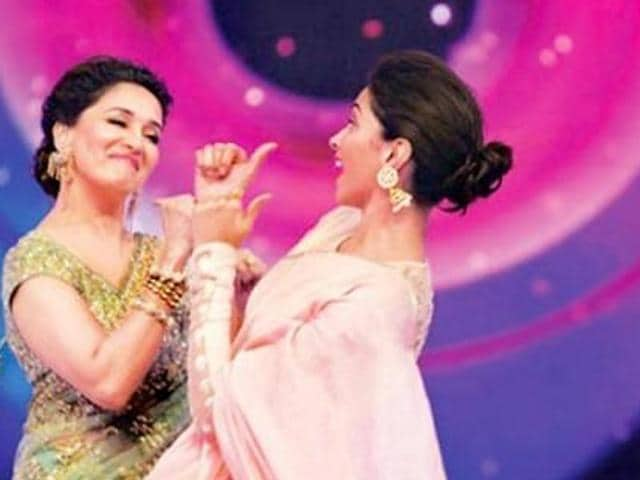 A source reveals that Madhuri Dixit Nene and Deepika Padukone bonded over movies at the event.