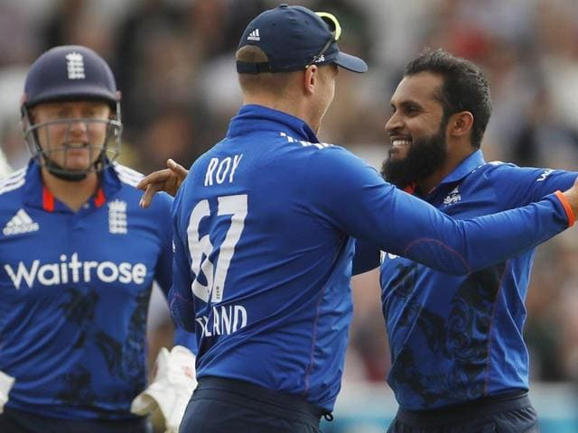 England's Jonny Bairstow celebrates his fifty with Moeen Ali.
