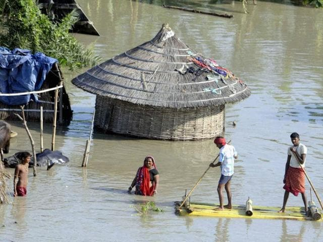 People wade on a banana raft in flood hit area of Hajipur, Bihar.