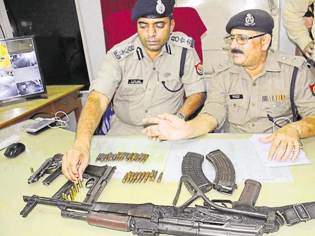 Police display the weapons they recovered from a cricket kit bag that was dumped by the fleeing attackers.