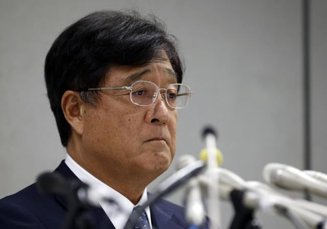 Mitsubishi Motors chairman Osamu Masuko at a press conference in Tokyo. Japanese transport ministry officials raided the Tokyo headquarters of scandal-ridden Mitsubishi on Friday, September 2, 2016 after the government alleged the automaker cheated on mileage ratings on more models than earlier reported.