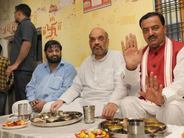 BJP chief Amit Shah and UP BJP state president Keshav Prasad Mauryia  with the party's Dalit MP Kaushal Kishore at his residence in Dubagga, Lucknow  on August 13, 2016, where Kishore's wife Jaya serves meal to the leaders.