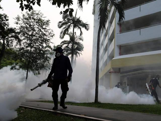 Workers fogging in the housing estate at Aljunied Crescent in Singapore. Singapore reported 40 more cases of locally transmitted Zika virus infections, most of them foreign workers at a construction site.