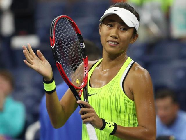 Shuai Zhang of China hits a return against Samantha Stosur of Australia.