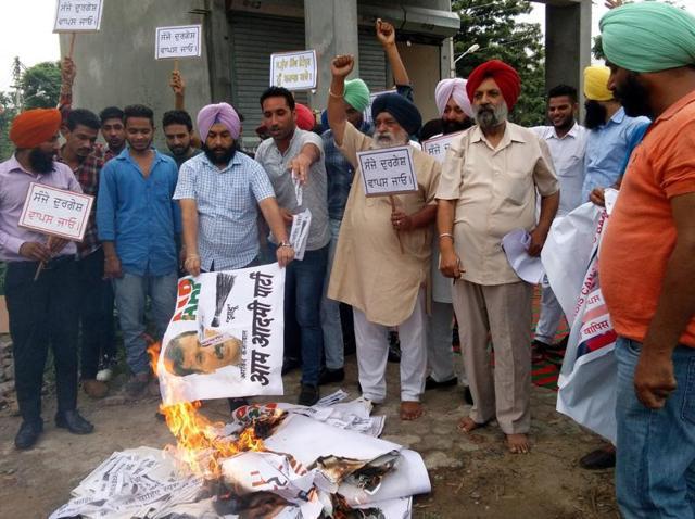 AAP protesting against Arvind Kejriwal in Nawanshahr on Thursday.