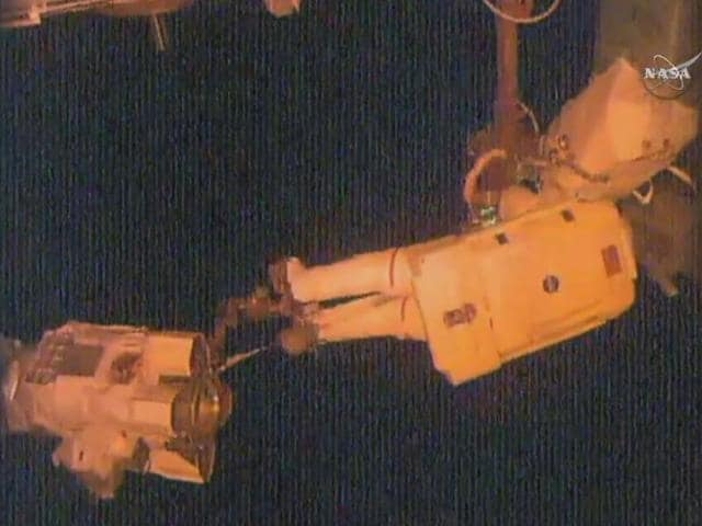 This NASA TV video grab shows NASA astronaut Jeff Williams making repairs and installing new equipment during a spacewalk at the International Space Station on September 1, 2016.