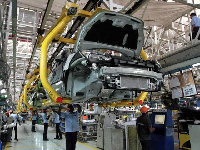 Workers assemble Ford cars at a plant of Ford India in Chengalpattu on the outskirts of Chennai.