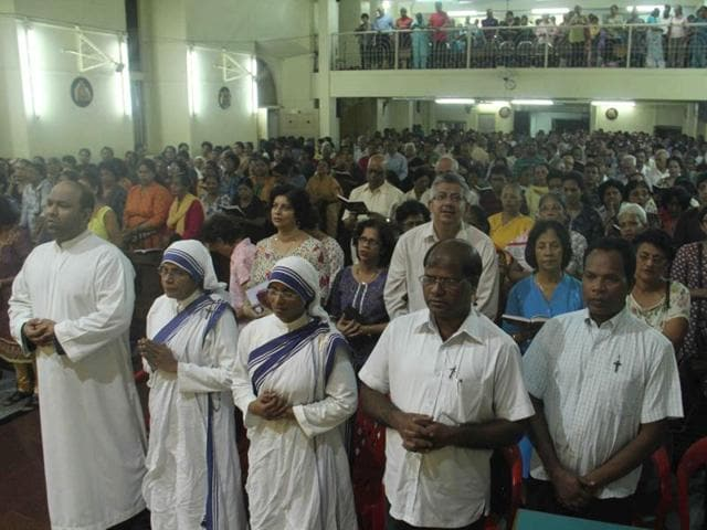 People pray at the special service organised by Our Lady of Immaculate Conception church, Borivli, for Mother's canonisation in Mumbai on Friday.