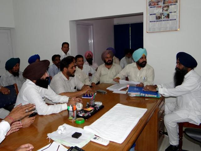 SAD-BJP councillors meeting with district planning committee chairman Tirath Singh Mahla (right) in Moga on Friday.