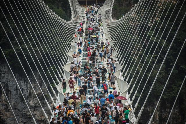The bridge over a valley in Zhangjiajie in China's Hunan Province  was opened on August 21, 2016. The glass-floored bridge is the world's longest and highest.