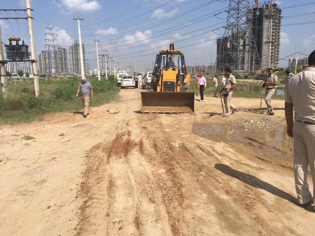 A Huda team supported by 100 policemen opened a 11-foot revenue road at Rambir Ki Dhani on Saturday.
