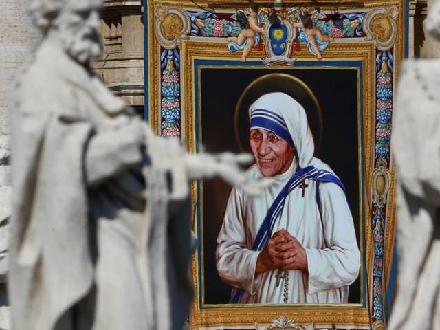 A tapestry depicting Mother Teresa of Calcutta is seen in the facade of Saint Peter's Basilica during a mass, celebrated by Pope Francis, for her canonisation in Saint Peter's Square at the Vatican.
