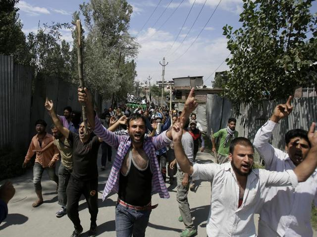 Kashmiris shout slogans during the funeral of a man  who reportedly drowned in the Jhelum river when he, along with other protestors, was chased by security forces during a protest.