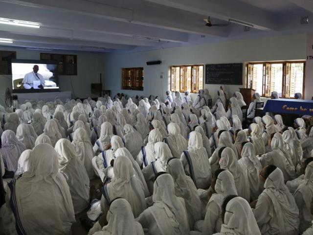 Catholic nuns follow the canonisation mass of Mother Teresa inside the Mother House, the Missionaries of Charity headquarters, in Kolkata.