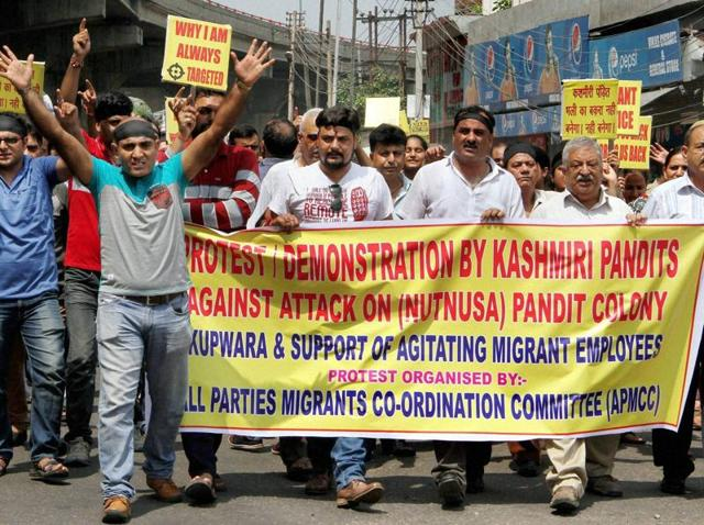 Kashmiri Pandits, along with members of Kashmiri Migrant Employees Association, stage a protest in Jammu.