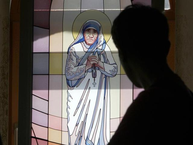 A boy looks at a portrait of Mother Teresa on a stained glass window at Mother Teresa Memorial House in Skopje, Macedonia, Sunday, Sept. 4, 2016.