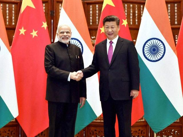 Prime Minister Narendra Modi and Chinese President Xi Jinping pose for photographers as they shake hands before a bilateral meeting at Westlake State House in Hangzhou, China on Sunday.