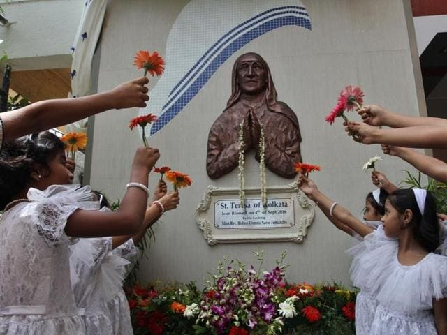 A nun pays tribute to Mother Teresa at St Lawrence School  in Thane on Sunday.