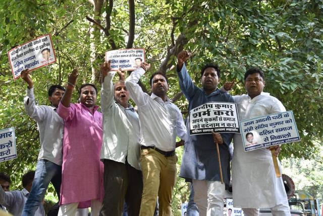 People protest against AAP's Sandeep Kumar, at the leaders residence in New Delhi on Saturday.
