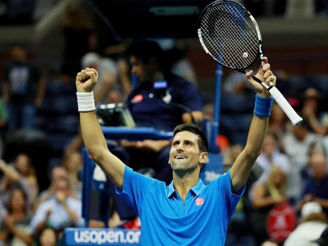 Novak Djokovic celebrates his win over Kyle Edmund.
