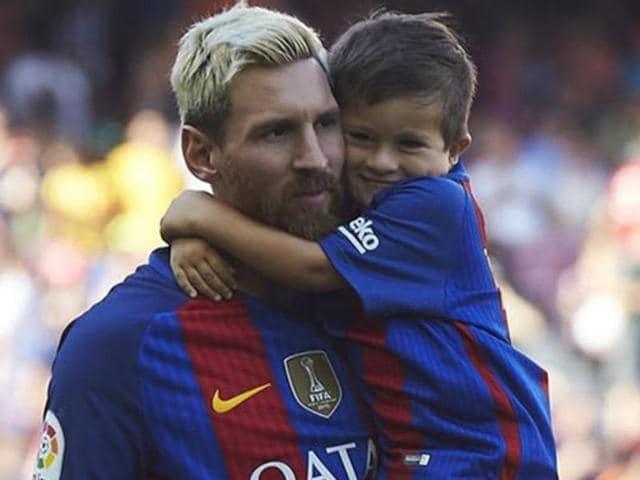 Lionel Messi with son Thiago.