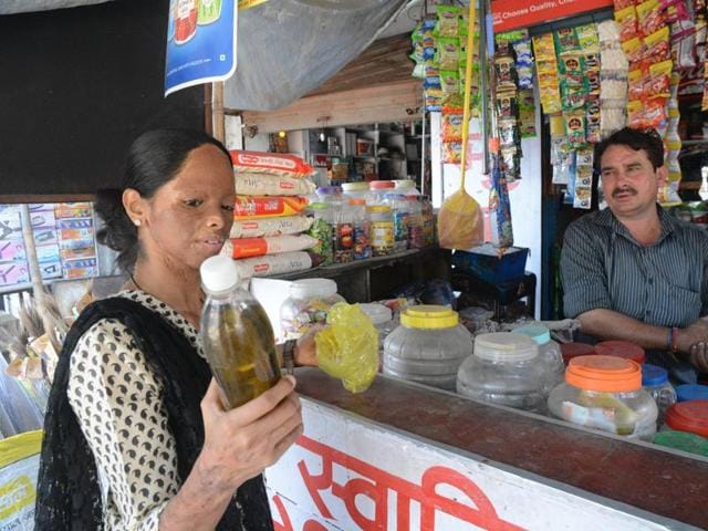 """Laxmi, one of the members of the """"Shoot Acid' campaign, buys acid from a shop in Kanpur"""