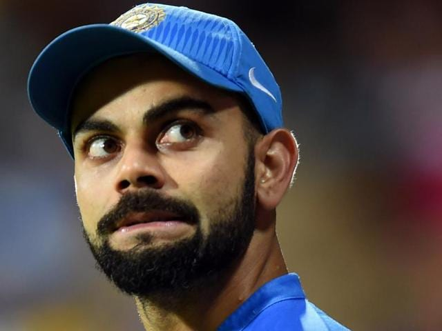 India's Virat Kohli, right, plays a shot as West Indies' Andre Fletcher looks on.