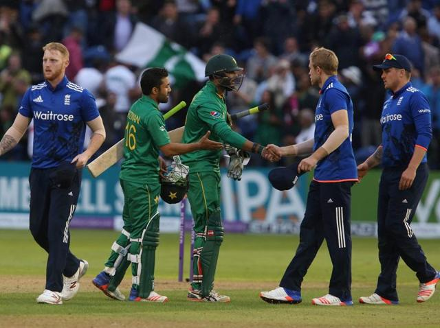 England's captain Eoin Morgan lifts the Royal London one day series trophy as his players celebrate with champagne. England won the series 4-1.