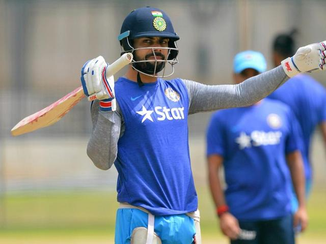 Indian Test cricket captain Virat Kohli gestures during a net practice session at the National Cricket Academy.