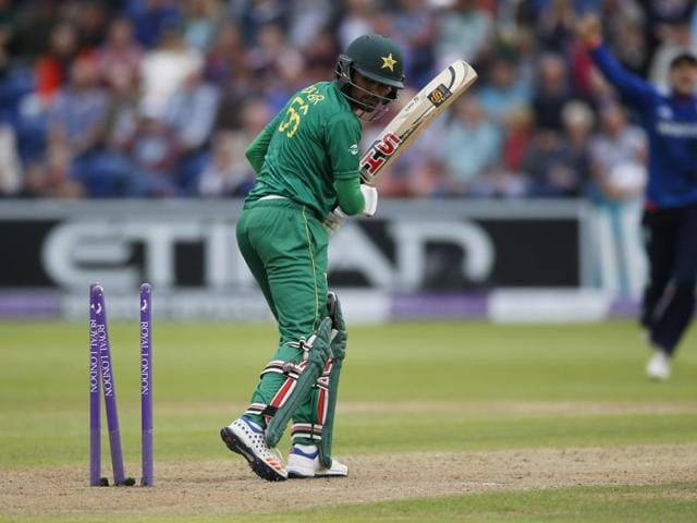 Pakistan's Babar Azam is bowled out by England's Mark Wood.