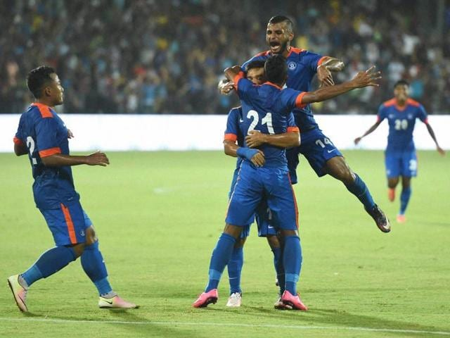Indian football players celebrate the goal against Puerto Rico in Mumbai.