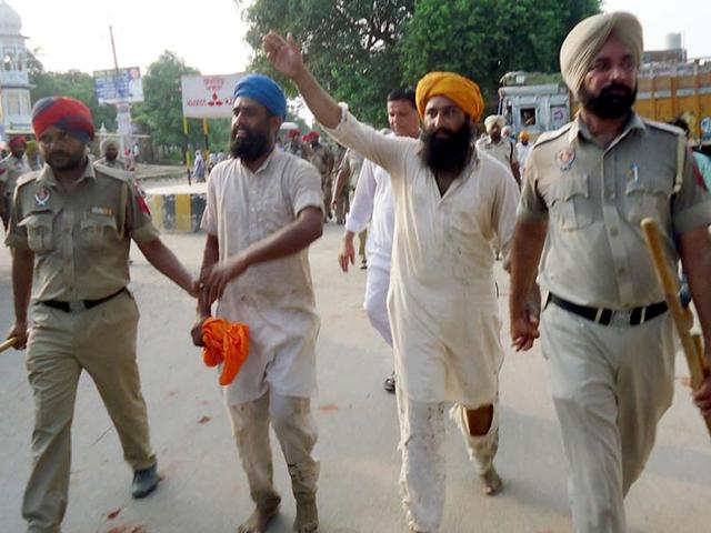 Farmers being detained by police during a protest in Patti, Tarn Taran, on Monday.