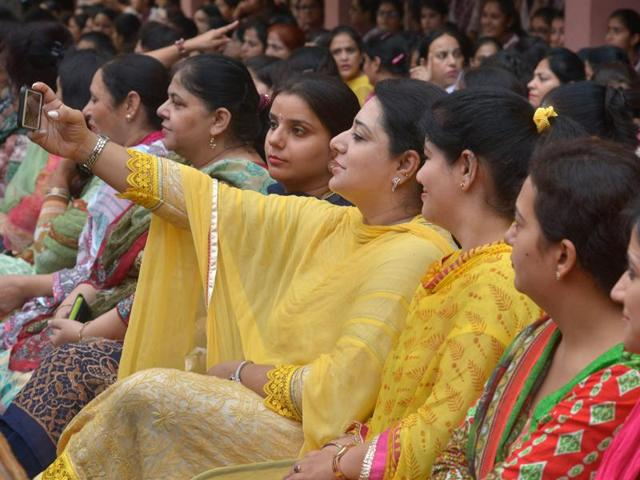 A school teacher takes a selfie during celebrations for 'Teacher's Day' at a school in Amritsar on September 5. September 5, is the birth anniversary of former President Sarvapalli Radhakrishnan, an influential scholar in comparative religion and philosophy, and is celebrated as Teachers' Day .