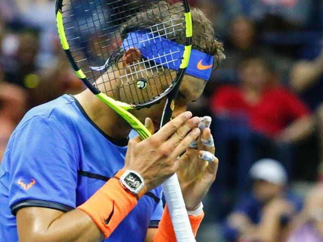 Lucas Pouille of France shakes hands after defeating Rafael Nadal of Spain.