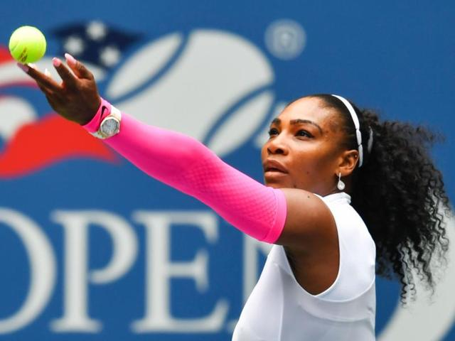 Serena Williams of US celebrates after defeating Johanna Larsson of Sweden.