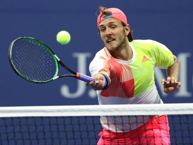 Lucas Pouille of France celebrates after defeating Rafael Nadal of Spain.