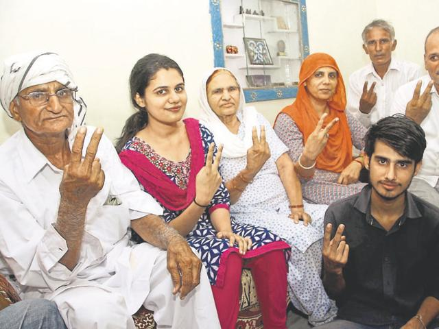 Shweta Suhag, who topped the Haryana Civil Services (executive) examination, with her family at their residence in Rohtak.