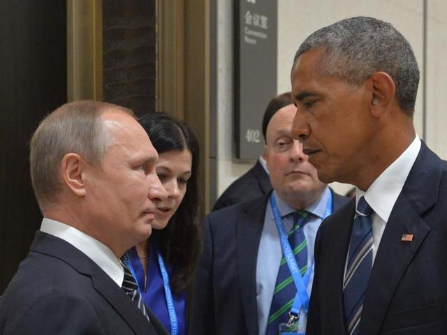 Russian President Vladimir Putin (left) listens to US President Barack Obama in Hangzhou on Monday.