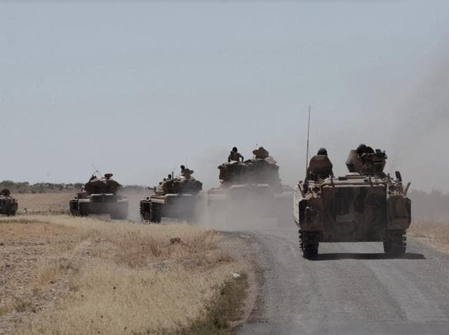 Turkish tanks head to the Syrian border, in Karkamis, Turkey. Turkish troops and allied Syrian rebels expelled the IS from Syrian-Turkish border.