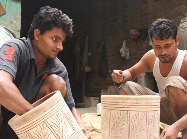 Potters from UttamNagar inNew Delhi are involved in manufacturing clay filters.