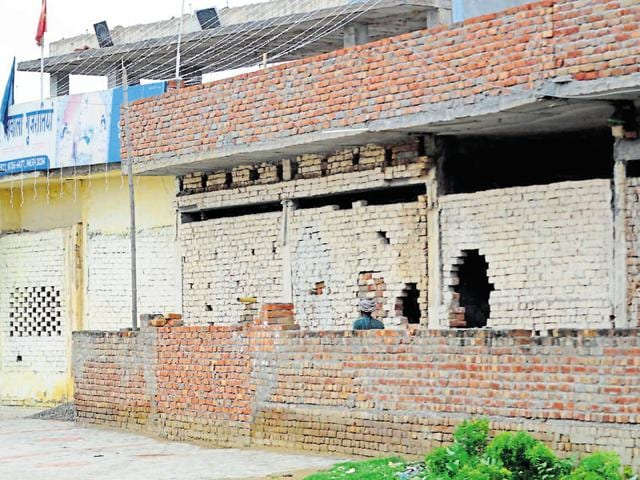 Illegal encroachment at the temple's property in Patiala on Sunday.